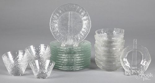 Colorless glass plates and bowls.