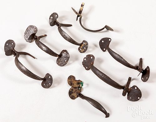 Seven wrought iron bean style thumb latches
