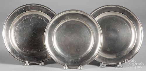 Three Philadelphia pewter plates, late 18th c.