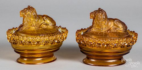 Pair of glass lion candy dishes