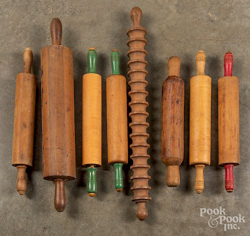 Collection of wooden rolling pins.
