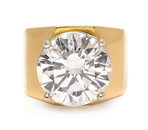 * An 18 Karat Yellow Gold and Diamond Solitaire Ring,