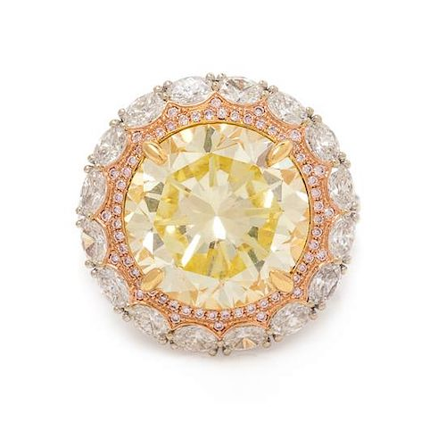 An 18 Karat Tricolor Gold, Fancy Yellow Diamond, Diamond and Colored Diamond Ring, 10.10 dwts.
