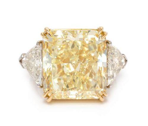 A Platinum, 18 Karat Yellow Gold, Fancy Yellow Diamond and Diamond Ring, Oscar Heyman & Brothers, 8.20 dwts.