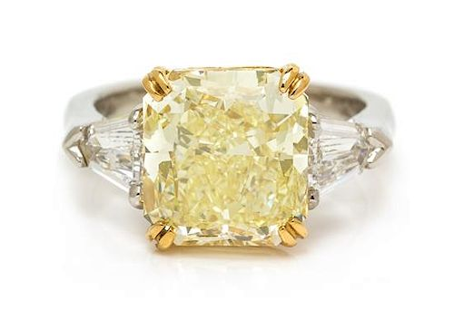 A Platinum, 22 Karat Yellow Gold, Fancy Yellow Diamond and Diamond Ring, 8.00 dwts.