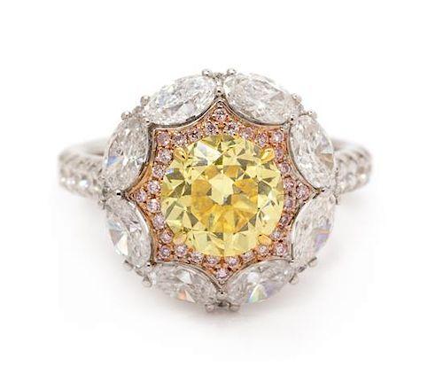 An 18 Karat Tricolor Gold, Fancy Vivid Yellow Diamond, Diamond and Colored Diamond Ring, 4.90 dwts.