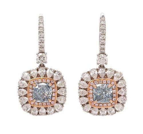 A Pair of 18 Karat Bicolor Gold, Fancy Green-Blue Diamond, Fancy Greenish Blue Diamond, and Diamond Earrings, 3.90 dwts.
