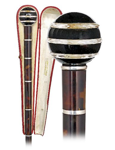 5. Evening Hard Stone and Tortoiseshell Dress Cane -Ca. 1900 -Black onyx and faceted rock crystal ball handle presented on a longer stem consisting of