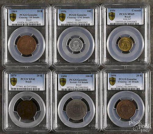 Six assorted Brazilian coins, to include a 10 C, 1956, PCGS genuine details, a Cruzeir, 1956