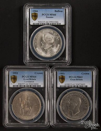 One Panamanian silver Balboa, 1966, PCGS MS-66, together with two British Crowns, 1951, PCGS PR-61,
