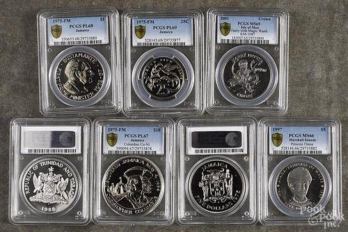 Four Jamaican coins, 1975-FM, to include a 25C, PCGS PL-69, a $1, 1975-FM, PCGS PL-68, a $5
