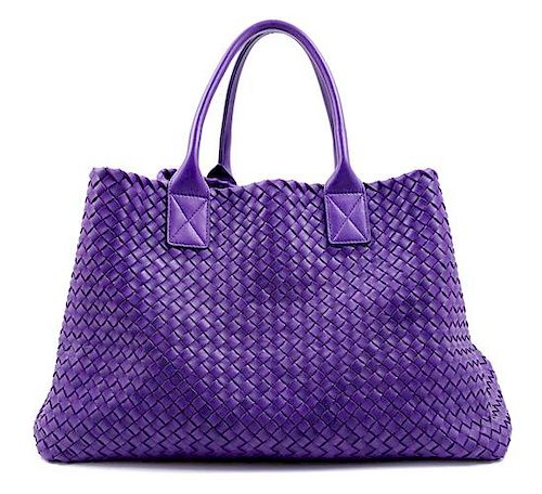 """A Bottega Veneta Purple Intrecciato Leather Tote, 11.25"""" H x 19.5"""" W x 9"""" D; Handle drop: 7""""; Pouch: 6.25"""" x 10.5""""."""