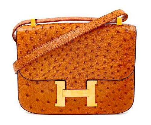 """An Hermès Cognac Ostrich Constance Bag, 7"""" H x 9"""" W x 2"""" D; Strap drop: 14"""" or 8.5""""."""