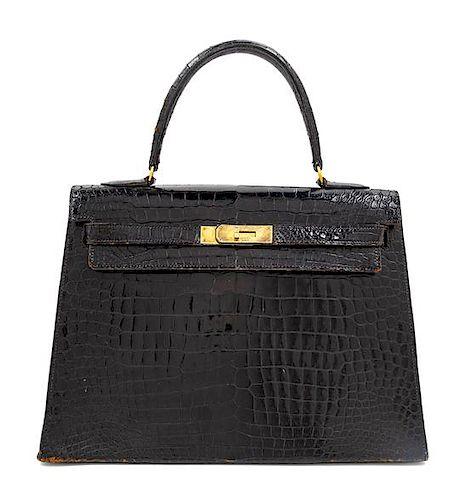 "An Hermès Vintage Black Crocodile Kelly Bag, 9"" L x 13"" W x 4.5"" D; Handle drop: 4.5""."