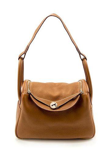 "An Hermès Gold Clemence Lindy 30 Handbag, 12"" x 7.5"" x 6""; Strap drop: 12""."