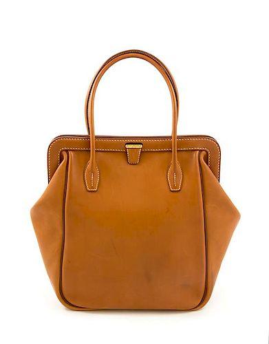 "An Hermès Natural Equestrian Leather Tote, 14"" H x 12""- 17"" W x 5.5"" D; Handle drop: 7""."