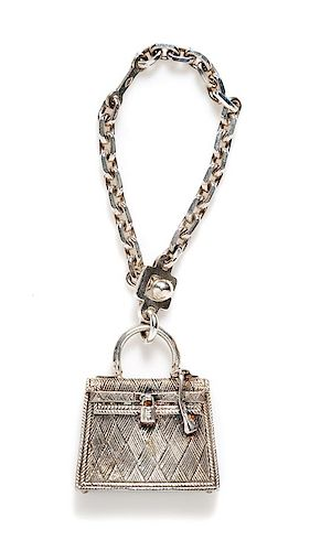 67e59bef32 An Hermès Sterling Silver Kelly Bag Touareg Charm