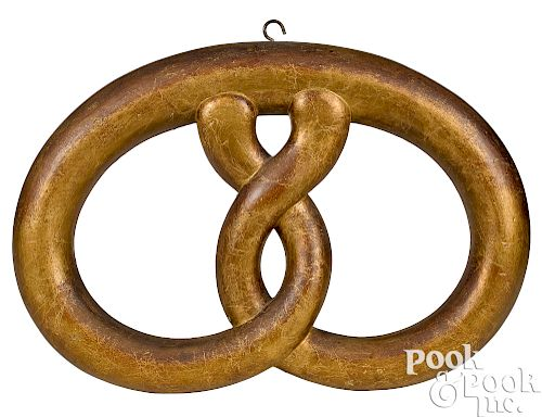 Painted giltwood pretzel trade sign