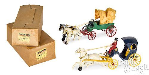 Two Kenton cast iron horse drawn wagons