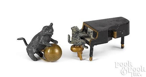 Two white metal figural cat tape measures