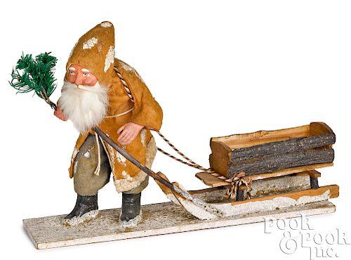 German Santa Claus pulling a sleigh