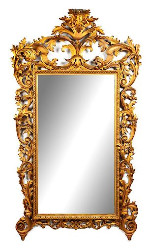 An Italian Giltwood Pier Mirror Height 83 x width 46 inches.