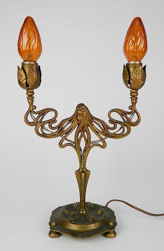 Brass Art Nouveau figural table lamp