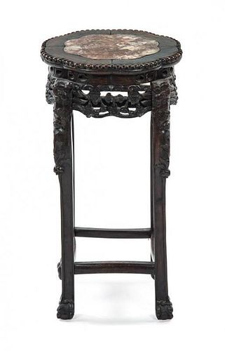 * A Hardwood and Marble Jardiniere Stand Height 23 3/4 x Diameter 12 3/4 inches.