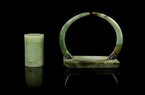 * Two Jadeite Articles Length of longest 4 5/8 inches.