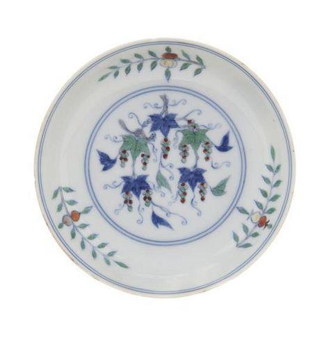 * A Doucai Porcelain Dish Diameter 4 1/2 inches.