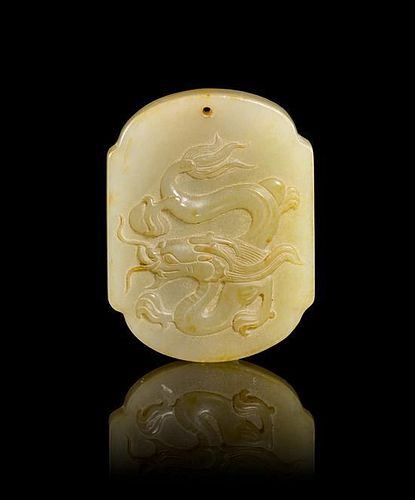 A Carved Jade Pendant Height 1 7/8 inches.