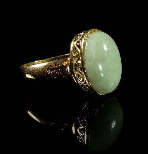 A 14 Karat Yellow Gold and Jadeite Ring Length overall 1 1/8 x width 3/4 inches.