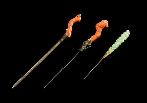 A Pair of Coral Hair Pins Length of longest 7 1/4 inches.