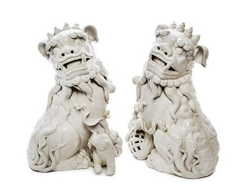 A Pair of Blanc-de-Chine Models of Fu Lions Height of first 15 inches.