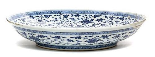 * A Blue and White Porcelain Charger Height 3 x diameter 15 inches.
