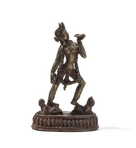 A Gilt Bronze Figure of a Vajrayogini Height 7 inches.