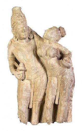 A Carved Sandstone Figural Group of Shiva and Parvati, Rajasthan Height 32 1/2 inches.