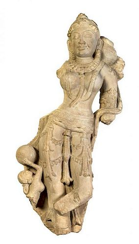 A Carved Sandstone Figural Group of Devi and Attendant, Rajasthan Height 36 inches.