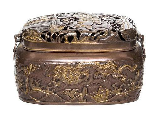 A Japanese Copper Handwarmer Height 3 x width 5 1/2 x depth 3 7/8 inches.