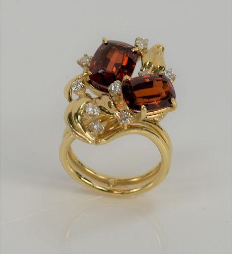 18 karat gold garnet and diamond ring, set with two rectangular garnets and nine brilliant cut diamonds.  size 7, 11.6 grams total w...