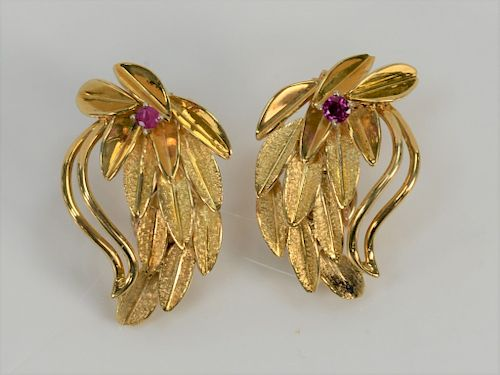 Pair of 14 karat gold leaf style ear clips, each set with small red stone, marked: JK.  11.8 grams.