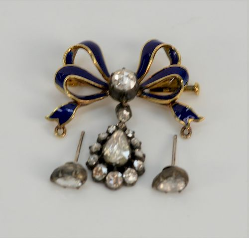 18 karat gold Austrian brooch, cobalt enameled, set with diamonds, .60 ct. rose cut diamonds in bow with hanging pear shaped diamond...