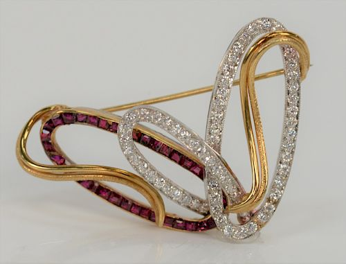 18 karat white and yellow gold brooch, set with diamonds and rubies.  height 1 1/4 inches, width 2 inches