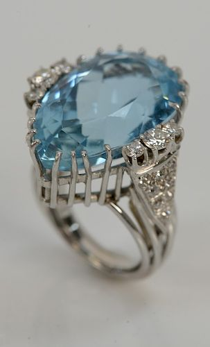 Platinum ring, set with pear shaped aquamarine approximately 21 cts. flanked by six round brilliant cut diamonds plus sixteen bead c...