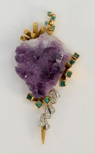 18 karat gold pendant set with amethyst stone mounted with nine diamonds and ten small emeralds.  height 2.25 inches,