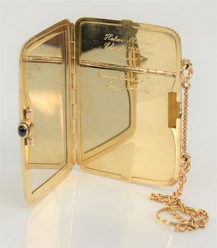 """14 karat gold compact with chain and sapphire, monogrammed, circa 1908.  2 1/8"""" x 3"""", 98 grams (without mirror)"""