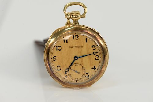 Patek Philippe 18 karat open face pocket watch, marked: made for Henry Kohn & Sons, Htfd, CT, with 18 karat and cloth fob.  43.9 mm