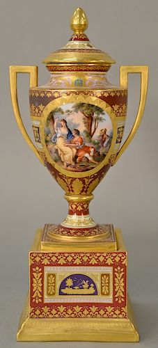 Meissen urn with cover having two gilt handles,  urn with romantic oval panels and raised gold surround, on square pedestal base.  h...