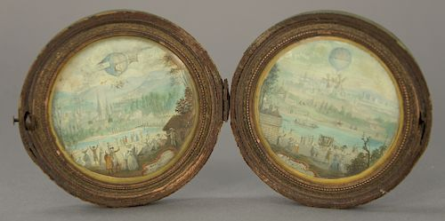 Pair of Round French miniature hot air balloons landscapes,  gouache on paper in round shagreen folding case, marked on bottom: Albr...
