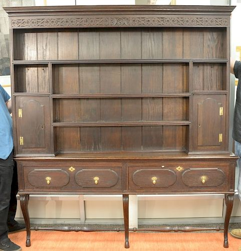 Custom Welsh style cupboard in two parts, upper section with shelves and two doors, with two doors on lower section, on cabriole leg...